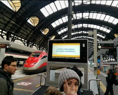 Status Perjalanan (19), Welcome to Milan