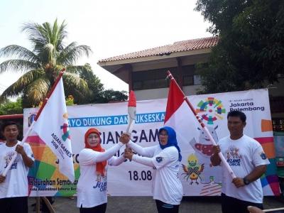 Jelang Asia Games 2018, Warga Semanan Kalideres Gelar Pawai Obor