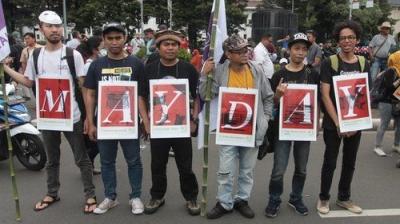 May Day dan Hardiknas sebagai Alarm Penting